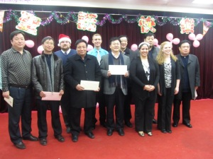 Presenting Christmas cards to the Education Bureau and four principals.